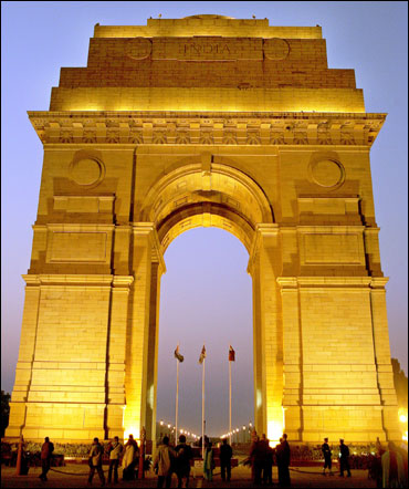People walk near the historic India Gate.