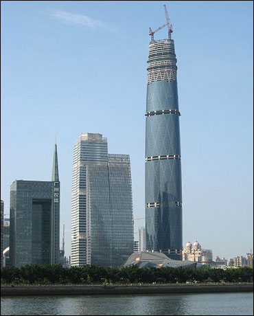 Towers in Guangzhou's CBD (left-center) with IFC/West Tower (right) and Guangzhou Opera House (front).