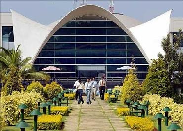 Staff walk around Infosys Technologies campus in Bangalore