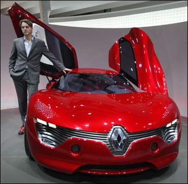 Laurens van den Acker, Renault's design director, poses next to Dezir.