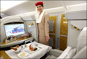 A flight attendant poses in the first class section of Emirates' Airbus A380.