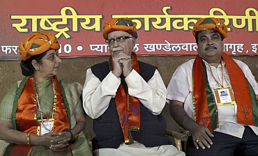 BJP leaders Sushma Swaraj, L K Advani and Nitin Gadkari.