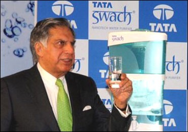 Ratan Tata posing with Swach, the low-cost water filter