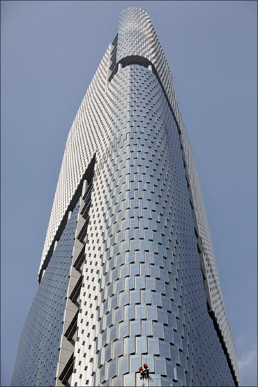 Window cleaners wash windows of the Zifeng Tower in Nanjing, Jiangsu province.
