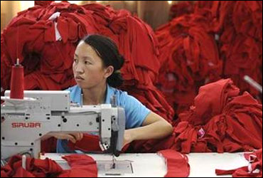 An employee works at a garment factory in Wuhu.