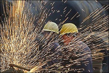 Migrant workers prepare steel bars at a residential construction site in Changzhi, Shanxi province.