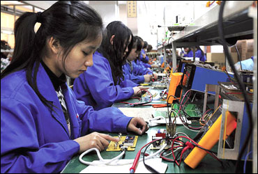 Workers in Hefei, China, assemble remote control panels for air conditioners and water heaters.