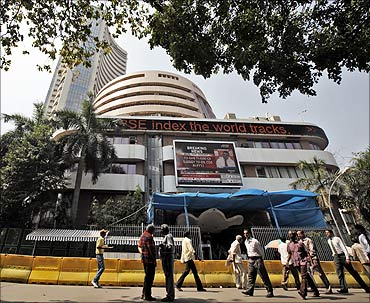 Commuters walk past the Bombay Stock Exchange (BSE) building in Mumbai.