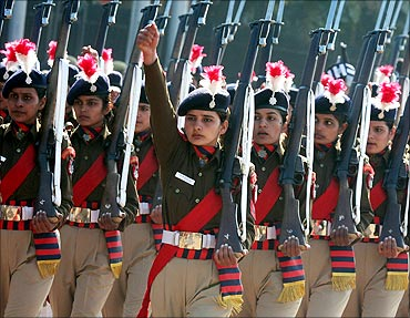 Indian policewomen march during the rehearsal for India's Republic Day parade.