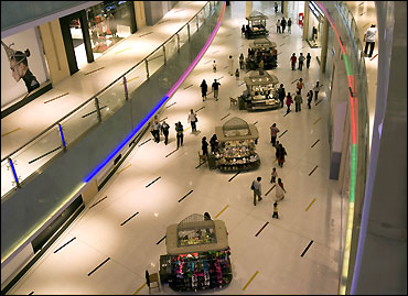 Shoppers move in the mall.