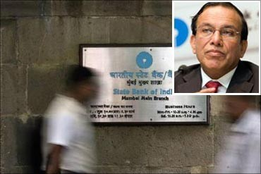 State Bank of India Chairman Pratip Chaudhuri (Inset).