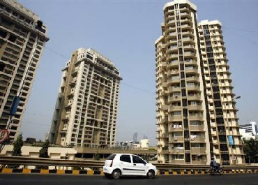 Hit by slowdown, realtors look abroad for help