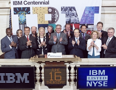 IBM Chairman and CEO Samuel Palmisano (center) and IBM executives ring The Opening Bell at the NYSE.