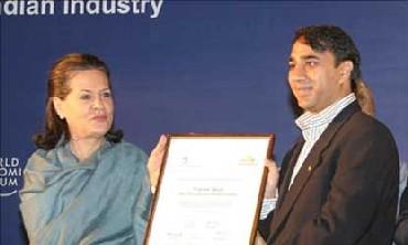 Sonia Gandhi felicitating Vikram Akula