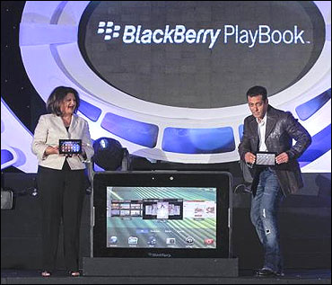 Frenny Bawa, MD of Research In Motion (RIM) India and Salman Khan (R) unveil the PlayBook.