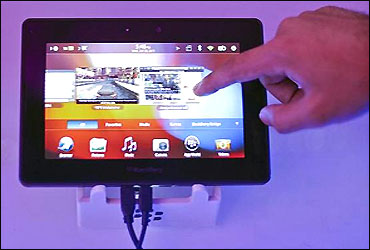 A conference attendee examines the BlackBerry PlayBook during its launch in Mumbai.