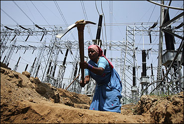 A labourer works at the construction site of a grid power station.