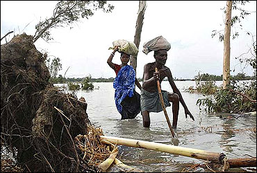 Flood-affected villagers make their way through a cyclone-hit area in the Sundarbans delta.