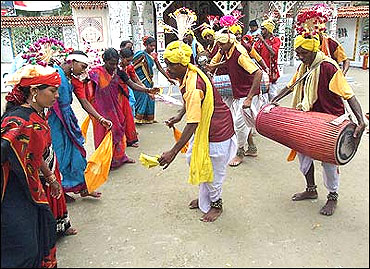 Tribal people from Chhattisgarh beat drums as they dance.