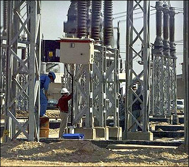 Labourers work at a power station.