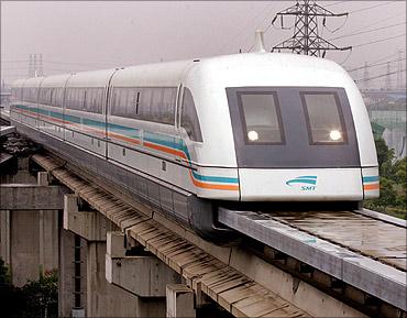Shanghai's maglev train (magnetic levitation) arrives at Long Yang station.