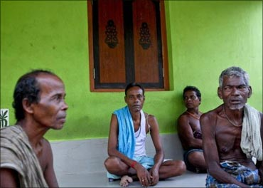 Villagers sit at the entrance to a house in Gobindpur.