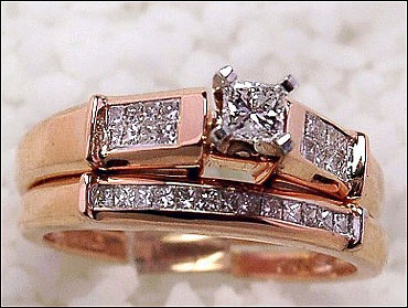 Princess cut diamond bridal set set in 14k pink-rose gold.