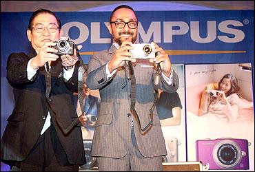 Olympus' senior manager, Asia Sales Group, Akira Fukui and Rahul Bose.