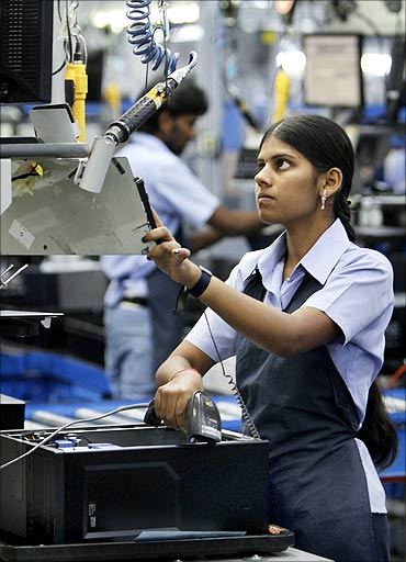 An employee assembles a computer on the production line at a Dell factory in Sriperumbudur.