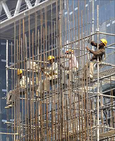 Labourers work at a construction site.