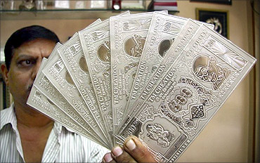 Rupee notes in silver.