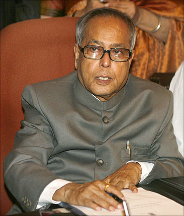 Pranab Mukherjee sits before giving the final touches to the Budget in New Delhi.