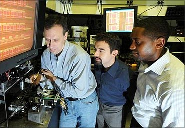 IBM scientists (L to R) Yurii Vlasov, William Green, S Assefa unveiled a new CMOS Integrated Silicon Nanophotonics chip technology.