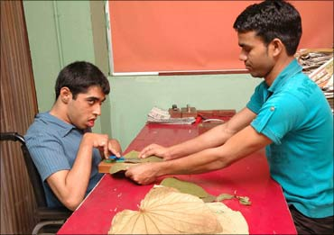 A patient of celebral palsy being helped by a volunteer