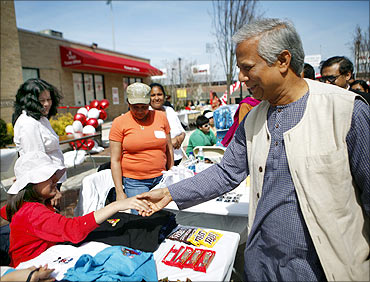 Muhammad Yunus greets borrowers at a Grameen America open house at St John's University in New York.