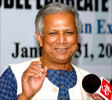 Muhammad Yunus addresses a press conference in New Delhi.