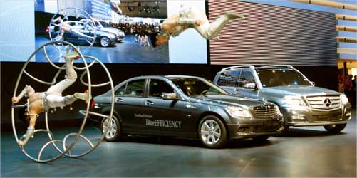 Artists perform as a Mercedes-Benz 200 CDI Blue Efficiency car and a GLK Bluetec Hybrid (R) car are presented.