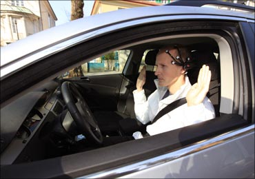 Daniel Goehring of AutoNOMOS research team at the Freie Universitaet demonstrates hands-free driving of the research car named 'MadeInGermany'.