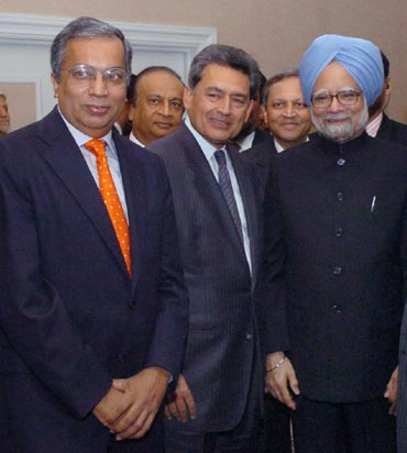 Gupta with Prime Minister Manmohan Singh.