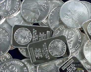 Silver at 31-year high; gold touches Rs 21,420/10 gm