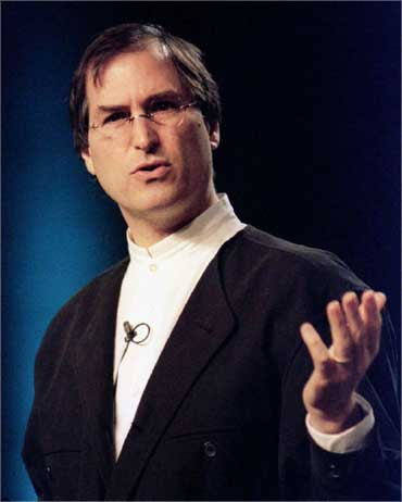 Steve Jobs, seen in a January 1997 file photo, rejoined Apple after the computer company purchased his NeXT software firm.