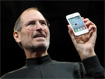 Jobs poses with iPhone 4 on June 7, 2010.
