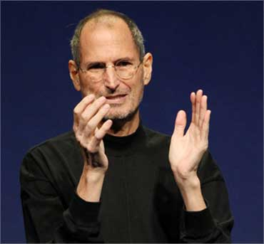 Jobs applauds at the conclusion of the launch of the iPad 2 on March 2, 2011.
