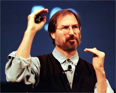Jobs talks during a presentation of Apple's G3 line of Macintoshes and PowerBooks at the Flint Center in Cupertino on Nov 10, 1997.
