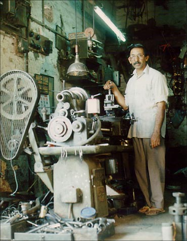 Iqbal Ahmed, with his lathe machine.