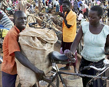 A man selling cassava pushes his goods through Lira Market in northern Uganda