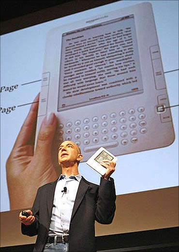 Amazon CEO Jeff Bezos with the Kindle.