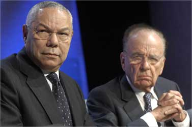 Former US Secretary of State Colin Powell (L) and Murdoch.