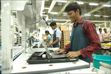 Rural Indians working at the Dell laptop assembly line in Sriperumbudur.