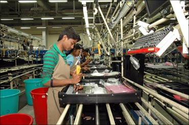 Rural Indians working at the Dell assembly line.